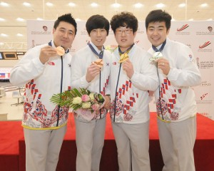 Korea's Kang Hee Won-Shin Seung Hyeon and Choi Bok Eum-Park Jong Woo withing the bronze and gold in the Doubles event
